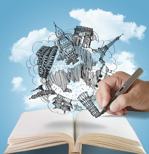 open book and hand drawing dream travel